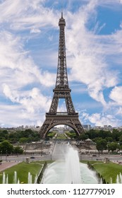 conic Landmark Steel Structure of Eiffel Tower in Paris France and Blue Sky and Clouds