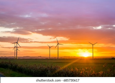 Conisholme Wind Farm in Lincolnshire at sunset