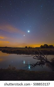 Conjunction of Jupiter and Venus over the river