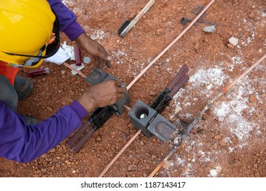 Connect copper grounding lightning protection system.Welding copper ground wire at construction site