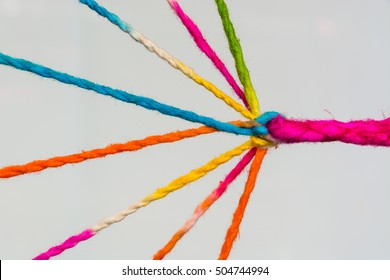 Connected group concept as many different ropes tied and linked together as an unbreakable chain as a community trust and faith metaphor. And red hearts