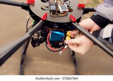 Connecting a battery on a drone.