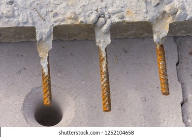 Connecting irons protrude from a precast concrete element over masonry