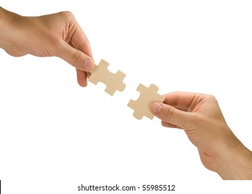 connection concept.  hands with pieces of puzzle on white background