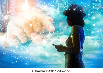 Connection concept, image of silhouette girl connection with her smartphone over the blue sky.