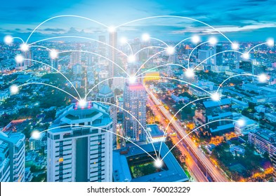 connection and network system concept over cityscape, green tone process