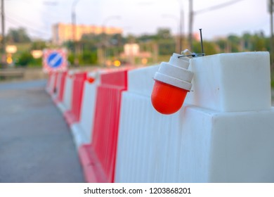 in connection with the repair of the road installed plastic ceiling and hanging lantern red, carefully repair the bridge