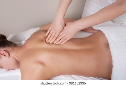 Connective tissue massage on a muscle group of a woman's back
