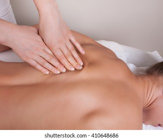 Connective tissue massage on  a woman's back
