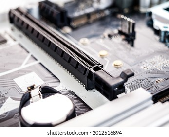 Connector, pci express bus connection slot, connection of a video card, drives to the motherboard of a desktop computer, close-up, selective focus