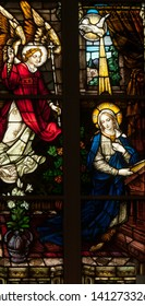 Connellsville, Pennsylvania/United States - May 31, 2019: Stained glass window depicting the Annunciation of Angel Gabriel to Mary