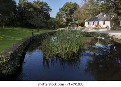 CONNEMARA, IRELAND - SEPTEMBER 17, 2017: Traditional white irish cottage in the Connemara National Park.