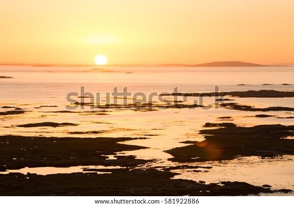 Connemara Sunrise sun on Horizon