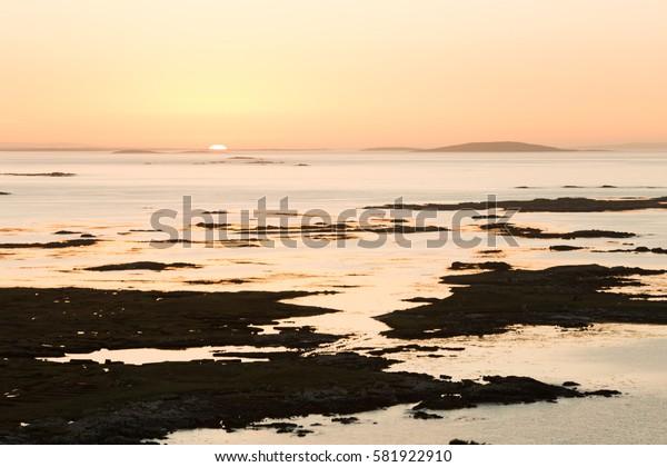 Connemara Sunrise sun under Horizon