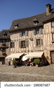 CONQUES, FRANCE - SEP 23 - Midday diners eat under the awning of a half-timbered house on Sep 23, 2011  in Conques, France
