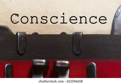 Conscience  typed on an old vintage paper with od typewriter font.