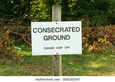 Consecrated ground sign at a cemetery implying it has been declared sacred or holy, and is can be used for Christian burial