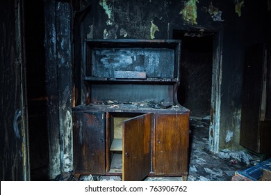Consequences of fire. Interior of the burned by fire house, burned furniture.