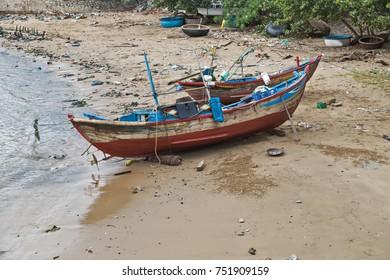 consequences of the hurricane Damrey, boat damages. garbage on beach Nha Trang, Vietnam
