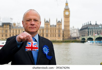 Conservative Politician Holding Union Jack Purse Outside The Houses Of Parliament In London.
