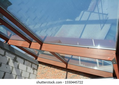 Conservatory roof under construction. Glass, skylight ceiling in new modern house