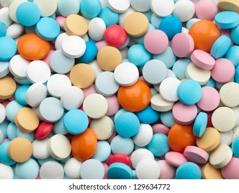 A considerable quantity of multicolored pills.