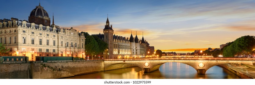 Consiergerie, Pont Neuf and Seine river with tour boat at sunny summer sunset, Paris, France