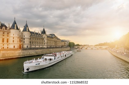 Consiergerie, Pont Neuf and Seine river st sunset in paris, france