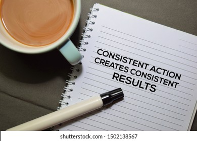 Consisten Action Creates Consistent Results text on the Book isolated on office desk background