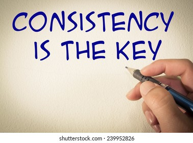 consistency is the key text write on wall