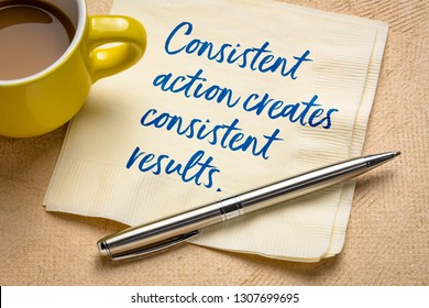 Consistent action creates consistent results - handwriting on a napkin with a cup of coffee
