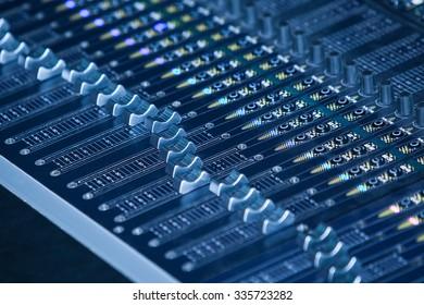 Console sound mixer closeup in blue