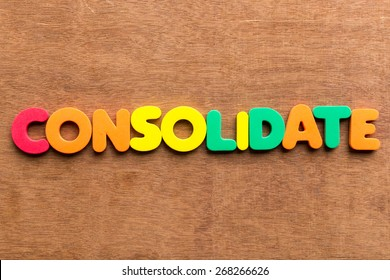 consolidate colorful word on the wooden background