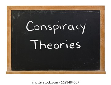 Conspiracy theories written in white chalk on a black chalkboard isolated on white