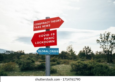 Conspiracy theory, fake news, Covid-19, panic, lockdown, global crisis road warning signs. Social media campaign for coronavirus plus total disorientation an fear in society