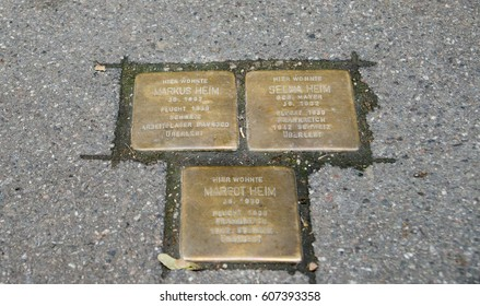 """CONSTANCE, GERMANY - JUNE 10, 2013: """"Stumbling blocks"""" at Konstanz, Germany. Plates inscribed with the name and life dates of victims of Nazi extermination or persecution."""