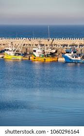CONSTANTA - January 06, 2018: Fishing ships in Constanta touristic harbor in winter sunny day