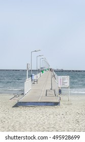 CONSTANTA, ROMANIA - SEPTEMBER 16, 2016: The bridge over Black Sea, seafront and seaside with blue water and gold sand.