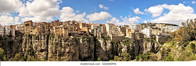 CONSTANTINE, ALGERIA - April, 2017: View of suspended bridge and old houses on the cliff at Constantine, Algeria. Panorama of Constantine city, Algeria