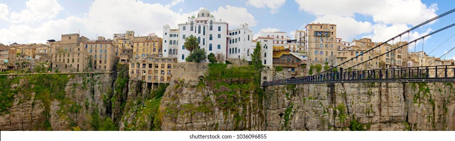 CONSTANTINE, ALGERIA - April, 2017: View of suspension bridges and old houses on the cliff at Constantine, Algeria. Panorama of Constantine city, Algeria