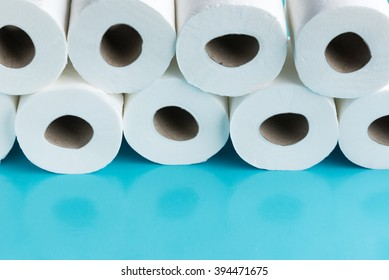 Constipation concept - Rolls of toilet paper against a blue background