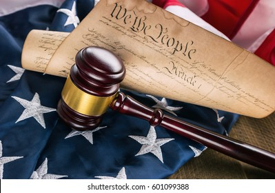 Constitution of america with judge gavel on a USA flag