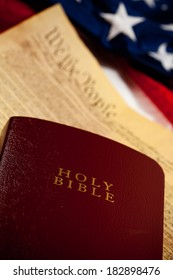Constitution: Focus on Bible with Constitution and Flag Behind