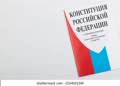 Constitution of the Russian Federation. The basis of the political, legal and economic systems of the state. The text written on the book is the constitution of the Russian Federation, with anthem.