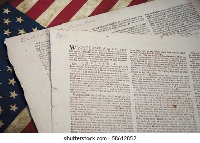 Constitution of the United States of America with a US flag background.