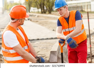 Construcion workers have a break in their job