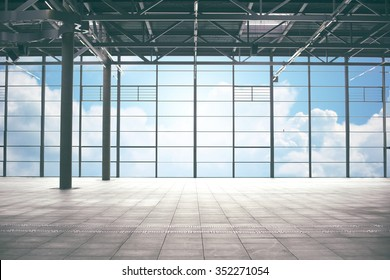 construction, architecture and building concept - airport terminal empty room over blue sky and clouds background