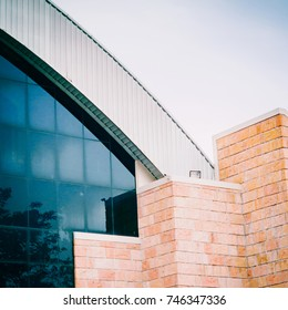 construction and architecture detail from modern building with glass window and brick