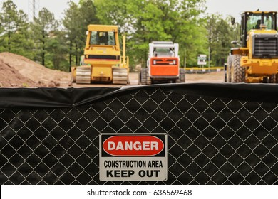 Construction area sign. Danger. Keep out. Construction machinery background