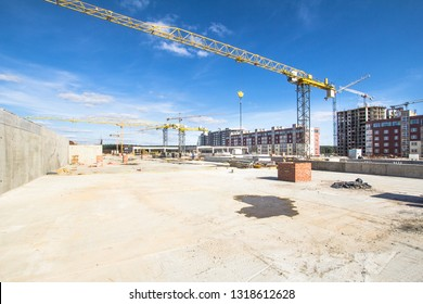 Construction area with yellow cranes at summer time.